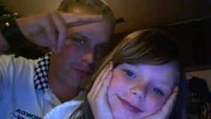 Shooting victim Christopher Whitmee is shown with his daughter Lexus in this undated family photo. (Handout)