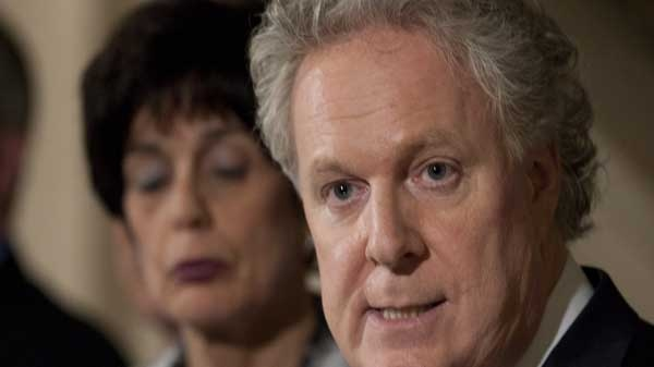 Quebec Premier Jean Charest announces a special legislation to allow students to go back to school Wednesday, May 16, 2012 at the legislature in Quebec City. Education Minister Michelle Courchesne, left, looks on. THE CANADIAN PRESS/Jacques Boissinot