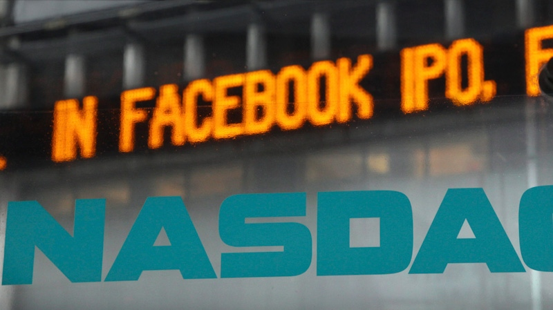 News about the Facebook IPO passes on a billboard outside of NASDAQ in Times Square, New York, Tuesday, May 15, 2012.  (AP / Seth Wenig)