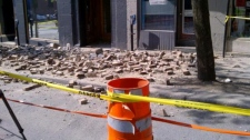 One man was critically injured when bricks fell from a building on Bleury St. (May 16, 2012)