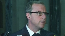 Saskatchewan Premier Brad Wall reacts to comments by NDP Leader Thomas Mulcair that he's a messenger for Prime Minister Stephen Harper in Regina on Wednesday, May, 16, 2012.