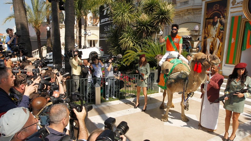 Actor Sacha Baron Cohen, right, sits on a camel during a photo call for The Dictator at the 65th international film festival, in Cannes, southern France, Wednesday, May 16, 2012. (AP / Joel Ryan)