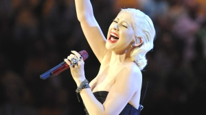 Christina Aguilera sings the national anthem before Game 6 of the NBA basketball finals between the Los Angeles Lakers and the Boston Celtics, Tuesday, June 15, 2010, in Los Angeles. (AP / Mark J. Terrill)