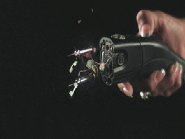 This still taken from a slow motion video shows the conductive agents of a taser exiting the weapon shortly after the trigger being pulled.