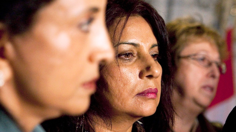 Members of the Air India Victims families Association Lata Pata, left to right, Daljit Kaur Sidhu, and Monique Castonguay listen to a press conference in the foyer of the House of Commons in Ottawa on Thursday June 17, 2010. (Sean Kilpatrick / THE CANADIAN PRESS)