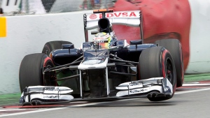 Williams driver Pastor Maldonado of Venezuela hits the wall during the second qualifying session at the Canadian Grand Prix in Montreal on Saturday, June 9, 2012. (Paul Chiasson / THE CANADIAN PRESS)