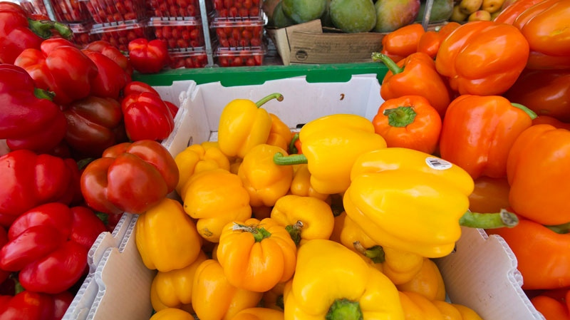 Fresh peppers and cherry tomatoes (top left) are on display for sale as people shop for fresh produce and vegetables at a small market on Bloor Street West in Toronto on Tuesday, June 7, 2011. (Nathan Denette / THE CANADIAN PRESS)