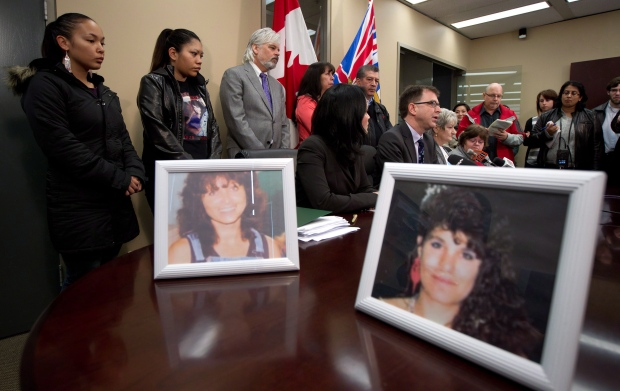 Photos of serial killer Robert Pickton victims Diane Rock, left, and Cara Ellis are displayed
