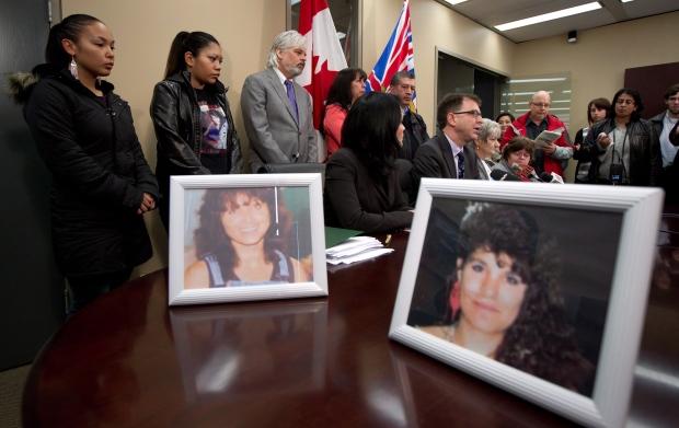 Photos of serial killer Robert Pickton victims Diane Rock, left, and Cara Ellis are displayed