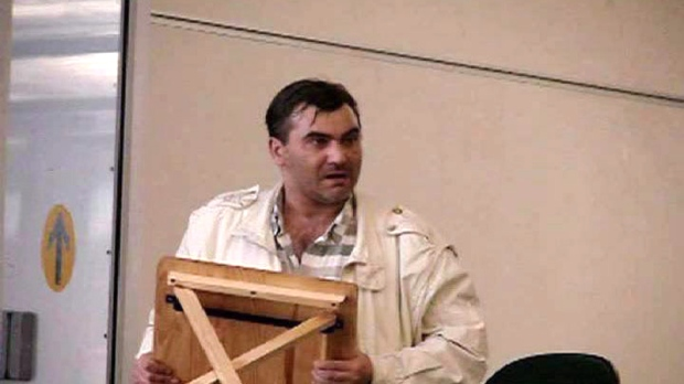 Robert Dziekanski holds a small table before being Tasered at the Vancouver Airport in this image from video.