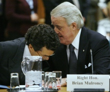 Former prime minister Brian Mulroney talks with his lawyer Guy Pratte prior to testifying before the Commons ethics committee on Parliament Hill in Ottawa on Thursday Dec. 13, 2007. (Sean Kilpatrick / THE CANADIAN PRESS)