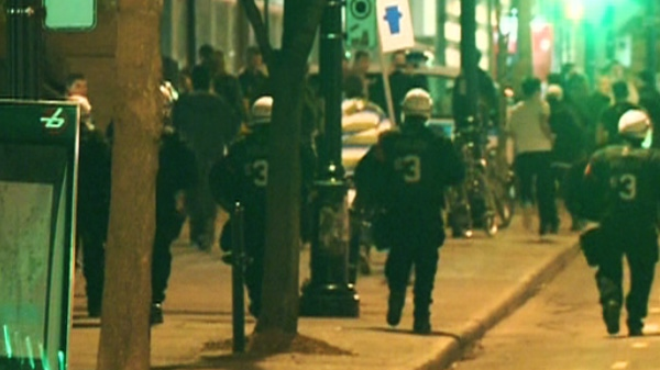 Police officers monitor protests during a night of demonstrations in Montreal on Wednesday, May 16, 2012.