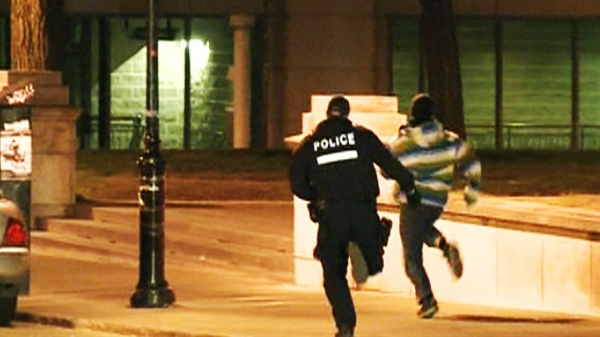 A police officer chases a protester after a night of demonstrations in Montreal on Wednesday, May 16, 2012.