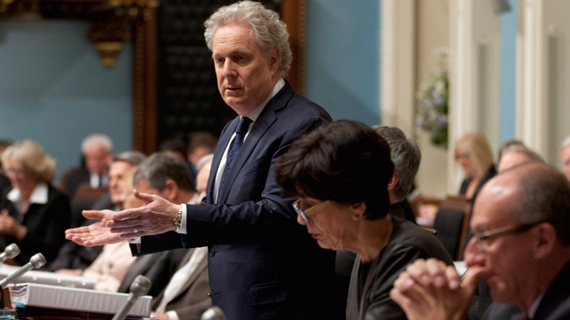 Quebec Premier Jean Charest responds to Opposition questions on an expected emergency law on tuition hikes as Education Minister Michelle Courchesne, centre, and Canadian Intergovernmental Affairs Minister Yvon Vallierres sit by his side during question period Thursday, May 17, 2012 at the legislature in Quebec City. (Jacques Boissinot / THE CANADIAN PRESS)