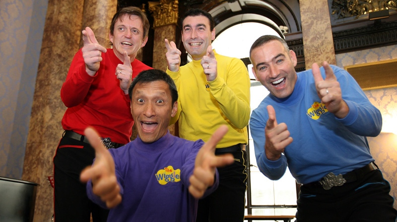 Australian children's entertainers 'The Wiggles,' Murray Cook (Red Wiggle), Greg Page (Yellow Wiggle), Jeff Fatt (Purple Wiggle), and Anthony Field (Blue Wiggle) make a special appearance at the Australian High Commission in London at the start of their UK tour, June 28, 2006. (AP / Christopher Pledger)