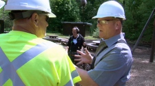 Mike Holmes is one of many who are helping rebuild a burned playground on Friday, May 18, 2012.
