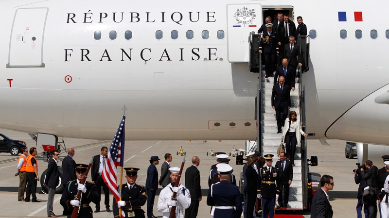 The French Delegation arrives to attend the G8 Summit at Dulles International Airport in Chantilly, Va., Friday, May 18, 2012. (AP / Jacquelyn Martin)