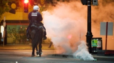 Police move in on protesters during a large demonstration designed as an act of defiance against a legal crackdown by the Quebec government, in Montreal, Friday, May 18, 2012. THE CANADIAN PRESS/Graham Hughes