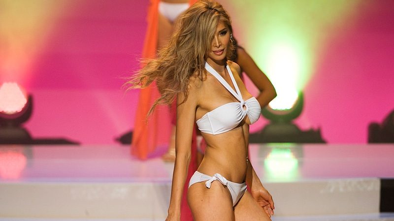 Jenna Talackova the first transgendered Miss Universe contestant is seen on stage during the preliminary round of the Miss Universe Canada contest in Toronto on Thursday May 17, 2012. (Aaron Vincent Elkaim / THE CANADIAN PRESS)