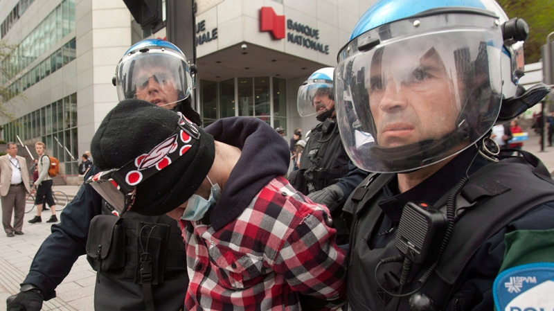 Police arrest a student who was taking part in a protest against tuition hikes in downtown Montreal, Tuesday, May 15, 2012. (Ryan Remiorz / THE CANADIAN PRESS)