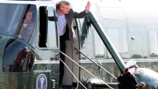 Prime Minister Stephen Harper waves from a helicopter en route to attend the G8 Summit at Dulles International Airport in Chantilly, Va., Friday, May 18, 2012. (AP / Jacquelyn Martin)