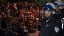 This photo taken from video shows Montreal police monitoring protesters in the streets of Montreal, Friday, May 18, 2012.