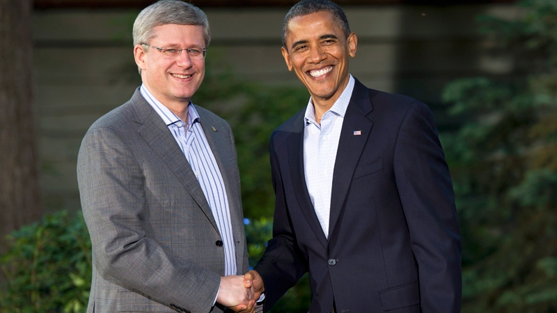Prime Minister Stephen Harper is greeted by U.S. President Barack Obama at a reception at the G8 summit in Camp David, MD., Friday, May 18, 2012. (Paul Chiasson / THE CANADIAN PRESS)