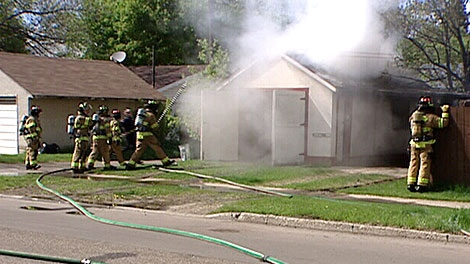 Crews work to extinguish one of a series of blazes set on the city's south side Saturday. May 19.