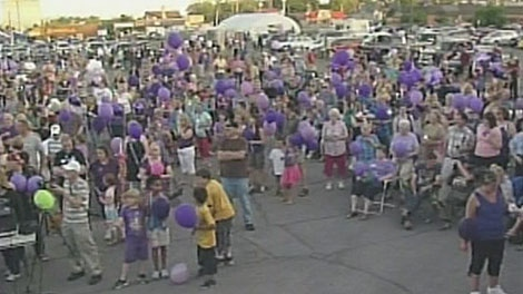 Dozens gather in Woodstock, Ont. wearing purple and carrying purple balloons to say goodbye to Tori Stafford on Saturday, May 19, 2012.