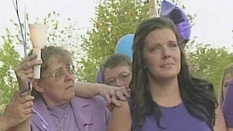 Tori Stafford's mother and grandmother cry at a ceremony to say goodbye to the murdered 8-year-old in Woodstock, Ont. on Saturday, May 19, 2012.