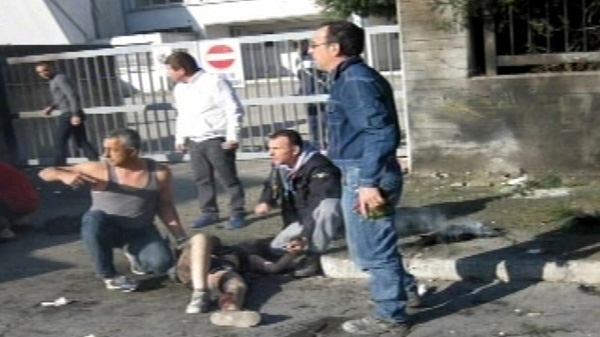 A woman receives first aid after an explosive device went off outside 'Francesca Morvillo Falcone' high school in Brindisi, Italy