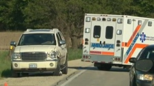 A damage vehicle is seen after colliding with a motorcycle near Orangeville, Ont., Saturday, May 19, 2012.