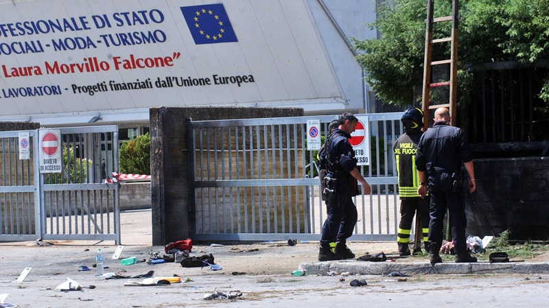 Italian firefighters inspect the site where an explosive device blasted outside 'Francesca Morvillo Falcone' high school in Brindisi, Italy