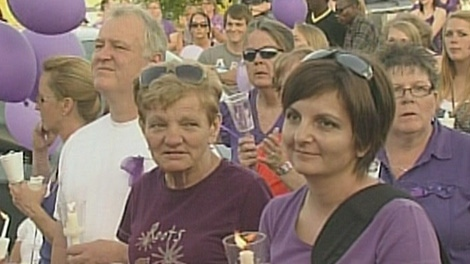 Woodstock, Ont. residents attend candlelight vigil that was held in memory of Tori Stafford, Saturday, May 19, 2012.
