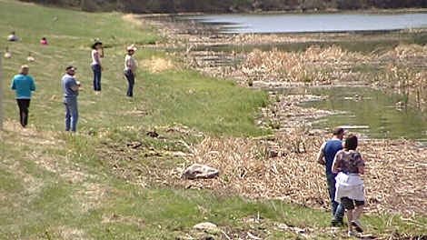 Family and friends search the shoreline for two boaters who have gone missing in the area of Coal Lake in the County of Wetaskiwin, south east of Edmonton. May 20.