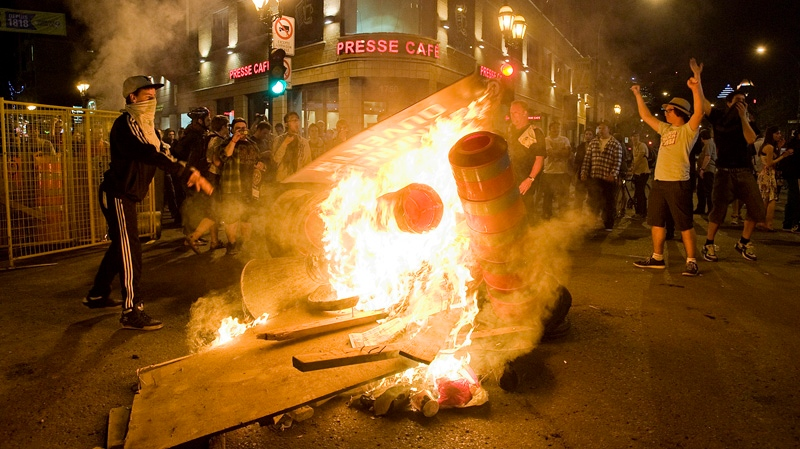 Protesters start a fire during a demonstration in Montreal, Saturday, May 19, 2012. A plan to restore order in Montreal appeared to erupt in smoke late Saturday, with a fiery blockades blazing on busy downtown streets. THE CANADIAN PRESS/Graham Hughes