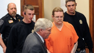 Convicted murderer Ronald Smith is escorted in for his clemency hearing at Powell County District Court in Deer Lodge, Montana, Wednesday, May 2, 2012. (The Missoulian, Michael Gallacher)