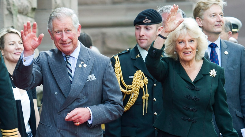 Prince Charles and his wife Camilla wave as they arrive at Queen's Park as the royal couple celebrate the 60th Queen's Diamond Jubilee anniversary in Toronto on Tuesday, May 22, 2012. (Nathan Denette / THE CANADIAN PRESS)