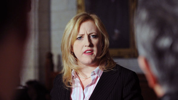 Minister of Labour Lisa Raitt delivers a statement in the foyer of the House of Commons on Parliament Hill in Ottawa on Tuesday, March 13, 2012. (Sean Kilpatrick / THE CANADIAN PRESS)