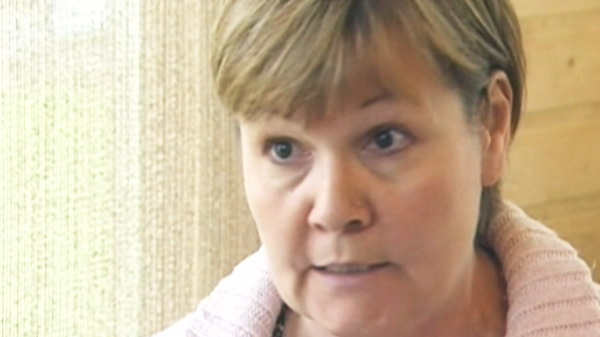 Carol DeDelley, McLean's mother is seen in this image.