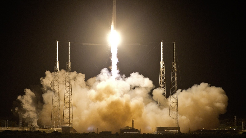The Falcon 9 SpaceX rocket lifts off from space launch complex 40 at the Cape Canaveral Air Force Station in Cape Canaveral, Fla., early Tuesday, May 22, 2012.