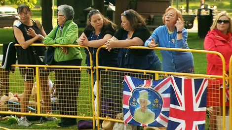 Royal fans wait hours before the arrival of Prince Charles and his wife Camilla in Toronto on Tuesday, May 22, 2012.