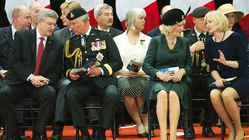 Prime Minister Stephen Harper, left to right, speaks with Prince Charles as the Duchess of Cornwall speaks to the prime minister's wife Laureen Harper at a ceremony at Fort York in Toronto