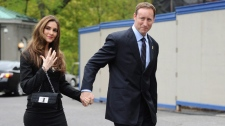 Peter MacKay arrives with Nazanin Afshin-Jam for the swearing in of the federal cabinet at Rideau Hall in Ottawa on Wednesday, May 18, 2011. (Sean Kilpatrick / THE CANADIAN PRESS)