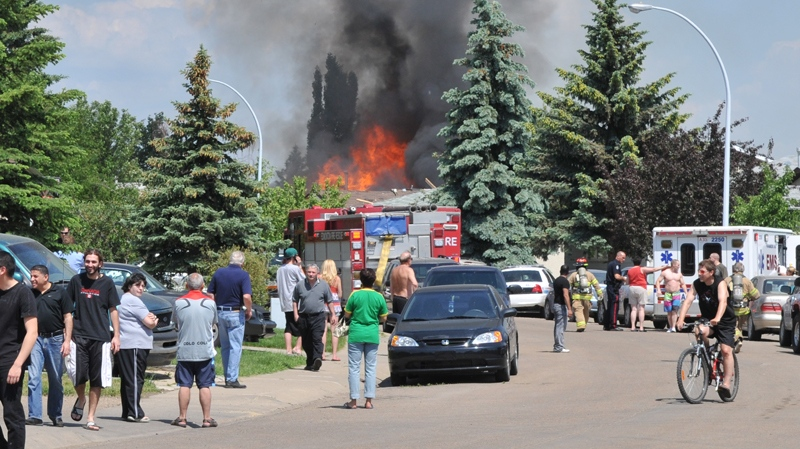 Fire crews arrive at the scene immediately following the house explosion in north Edmonton, Sunday, June 21, 2010. (Brendan Smith / MyNews.CTV.ca)