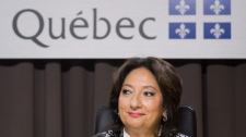 Justice France Charbonneau smiles as she sits on the opening day of a Quebec inquiry looking into allegations of corruption in the province's construction industry in Montreal, Tuesday, May 22, 2012. (Graham Hughes / THE CANADIAN PRESS)