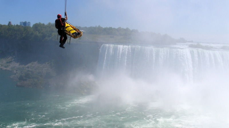 Niagara Falls emergency officials rescue a man who plunged over Niagara Falls and survived in an apparent suicide attempt, Monday, May 21, 2012. (AP / Harry Rossetani)