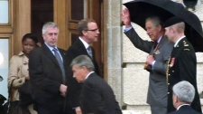 Prince Charles waves to people in Regina, Sask., Wednesday, May 23, 2012.