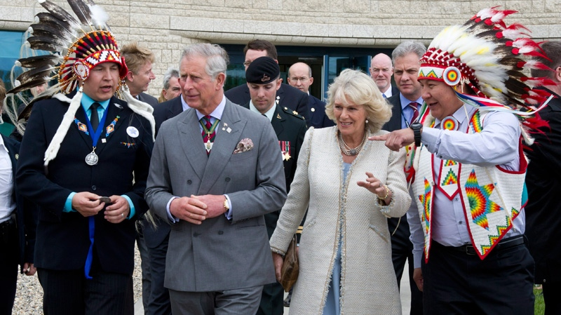 Prince Charles and his wife Camilla leave the Aboriginal University in Regina, on Wednesday, May 23, 2012. (Paul Chiasson / THE CANADIAN PRESS)