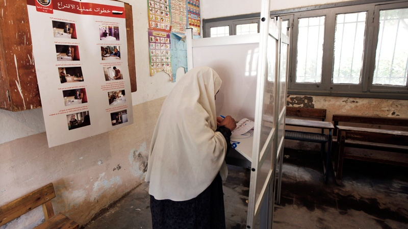 An Egyptian woman votes during the first day of the presidential election in a polling station in Alexandria, Egypt, Wednesday, May 23, 2012. (AP / Khalil Hamra)